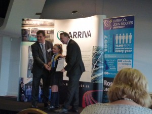Aiva receiving her award from Lord David Alton and Phil Stone ( regional managing director of Arriva).